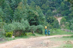 The Water Project: Mwembe Primary School -  Students Carrying Water To School
