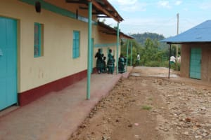 The Water Project: Mwembe Primary School -  Students Outside Their Classrooms