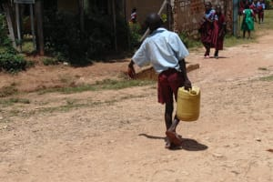 The Water Project: Jivuye Primary School -  Pupil Carrying Water To School