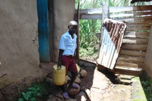 The Water Project: Jivuye Primary School -  Pupil With Water Container At Home