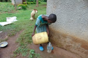 The Water Project: Friends Musiri Primary School -  Pupil Collecting Water At Home