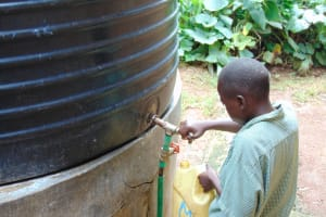 The Water Project: Friends Musiri Primary School -  Pupil Collecting Water For The School Cook