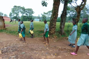 The Water Project: Friends Musiri Primary School -  Pupils Carrying Water