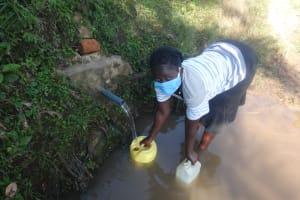 The Water Project: Mahira Community, Mukalama Spring -  Carolyne Fetching Water From Mukalama Spring