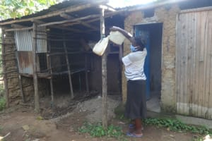The Water Project: Mahira Community, Mukalama Spring -  Carolyne Refills Her Home Handwshing Station