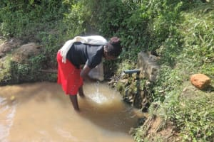 The Water Project: Mahira Community, Mukalama Spring -  Washing Container Before Fetching Water