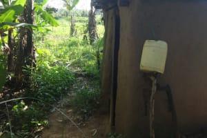 The Water Project: Mahira Community, Mukalama Spring -  Handwashing Station Outside Latrine