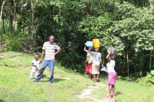 The Water Project: Lukala C Community, Livaha Spring -  Carrying Water