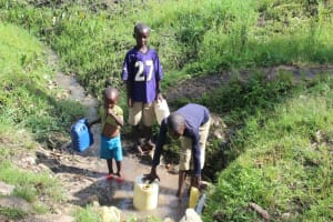The Water Project: Lukala C Community, Livaha Spring -  Children Fetching Water