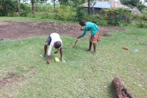 The Water Project: Lukala C Community, Livaha Spring -  Cleaning A Compound