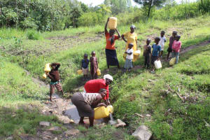 The Water Project: Lukala C Community, Livaha Spring -  Collecting Water