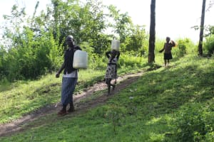 The Water Project: Lukala C Community, Livaha Spring -  Community Members Heading To Fetch Water