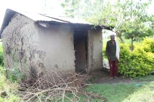 The Water Project: Lukala C Community, Livaha Spring -  Mama Fridah Outside The Kitchen