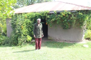 The Water Project: Lukala C Community, Livaha Spring -  Mama Fridah Outside Her Home