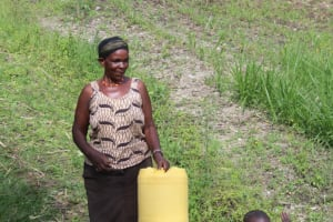 The Water Project: Lukala C Community, Livaha Spring -  Ms Ondiso Heading To The Water Point