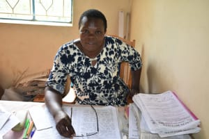 The Water Project: St. Peter's Ebunga'le Primary School -  Headteacher Aswani At Her Desk