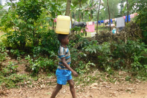 The Water Project: Mwitwa Community, Matiang'i Spring -  Taking Water Home From Matiangi Spring