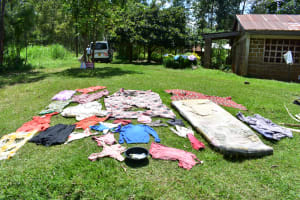 The Water Project: Shianda Township Community, Olingo Spring -  Clothes Drying On The Grass