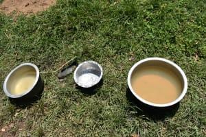 The Water Project: Shianda Township Community, Olingo Spring -  Short Term Storage At Home