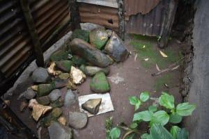The Water Project: Maraba Community, Shisia Spring -  Bathing Shelter Stone Floor