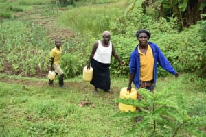 The Water Project: Maraba Community, Shisia Spring -  Taking Water Home From Shisia Spring