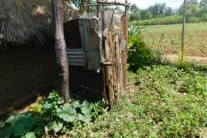 The Water Project: Eshimuli Community, Mbayi Spring -  Bathing Shelter