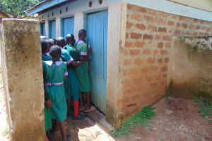 The Water Project: KG Jeptorol Primary School -  Girls At Their Latrines