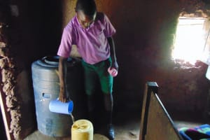 The Water Project: KG Jeptorol Primary School -  Pupils Fetching Water At Home