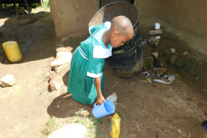 The Water Project: Kitambazi Primary School -  A Girl Fetches Water At Home