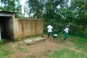 The Water Project: Kitambazi Primary School -  Boys Running To The Latrine And Urinal