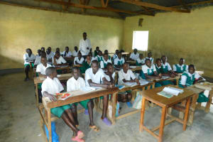 The Water Project: Kitambazi Primary School -  Students Participating In Class