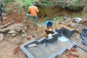 The Water Project: Mahira Community, Wora Spring -  Clay Works Ongoing To Seal Escape Channels