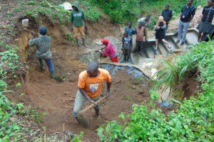 The Water Project: Mahira Community, Wora Spring -  Soil Backfilling