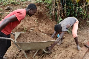 The Water Project: Mahira Community, Wora Spring -  Community Members Bring Materials To Site