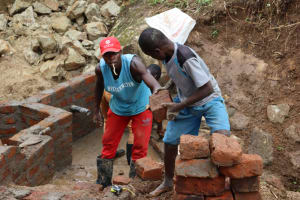 The Water Project: Mahira Community, Wora Spring -  Wall Construction