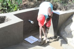 The Water Project: Litinye Community, Shivina Spring -  Tile Setting
