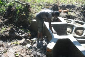 The Water Project: Litinye Community, Shivina Spring -  Clay Backfilling