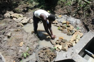 The Water Project: Litinye Community, Shivina Spring -  Stone