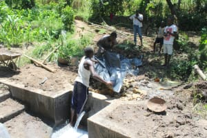 The Water Project: Litinye Community, Shivina Spring -  Pvc Backfilling