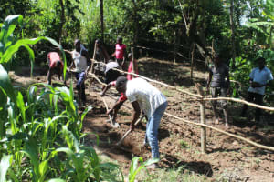 The Water Project: Litinye Community, Shivina Spring -  Digging Cut Off Drainage