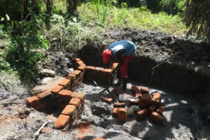 The Water Project: Litinye Community, Shivina Spring -  Wall Construction