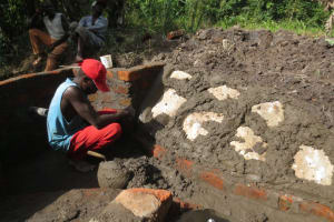 The Water Project: Litinye Community, Shivina Spring -  Stone Pitching Plaster