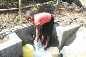 The Water Project: Litinye Community, Shivina Spring -  Enjoying Clean Water