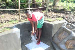 The Water Project: Litinye Community, Shivina Spring -  Enjoying Water