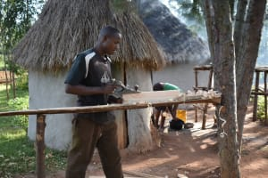 The Water Project: Machemo Community, Boaz Mukulo Spring -  Boaz At Work In Carpentry