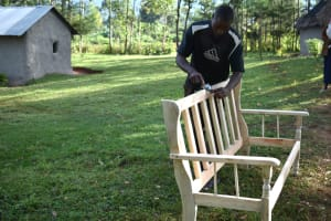 The Water Project: Machemo Community, Boaz Mukulo Spring -  Boaz Planing A Bench