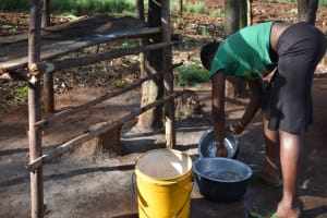 The Water Project: Machemo Community, Boaz Mukulo Spring -  Woman Washing Utensils