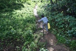 The Water Project: Makhwabuye Community, Majimazuri Lusala Spring -  Carrying Water