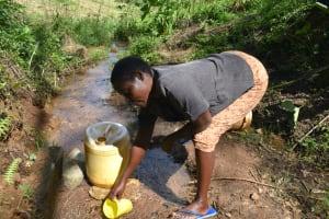 The Water Project: Makhwabuye Community, Majimazuri Lusala Spring -  Collecting Water