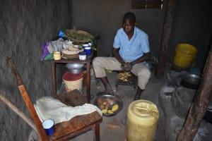 The Water Project: Makhwabuye Community, Majimazuri Lusala Spring -  Peeling Potatoes Inside The Kitchen